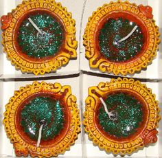 Item: Terracotta Diya with Gel - Set of 4    Details: Small Terracotta Diya with Green Sparkle Gel - Set of 4    Color: Earthen Color    (The actual products may look different in color, texture, and size from the digital images. Zoom images may take time to display.)    Price: INR: 180        Item #: SU43
