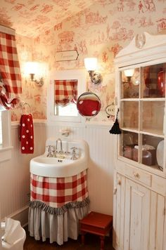 Red and white Country French bath with toile wallpaper...
