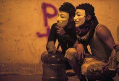 Demonstrators wear Guy Fawkes masks as they protest against the government of Venezuelan President Nicolas Maduro in Caracas on Feb. 24, 2014.