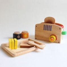 This wooden pop up toaster set made of sustainable rubber wood may just have my tornadoes bringing me breakfast in bed before I know it.