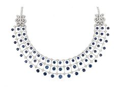 A highcarat sapphire diamond necklace in the style of Art-déco    18 ct. white gold. Elegant, flexible necklace with wide middle part, designed in the echo of van Cleef & Arpels and decorated with 63 round cut and moveable mounted sapphiers of varying sizes and of intensive blue colour in total c. 32 c.t and with 222 round cut diam. of good brillancy in total c. 7,20 ct. H-I.vvsi-P. W. 32 mm, l. c. 45 cm, weight c. 72 g.: