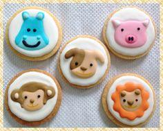 Animals icing cookies..