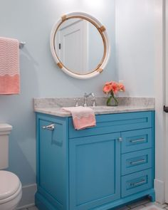 Colorful cabinetry and coral accents make for a pretty, sweet bathroom for one sweet girl. Light Blue Curtains, Pink Curtains, Pink Headboard, Pink Ottoman, Deeper Shade Of Blue, Pink Towels, Blue Colour Palette, Pink Room, Custom Cabinets