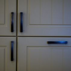 Paint Your Vinyl Kitchen Cupboards For An Inexpensive Design Fix.