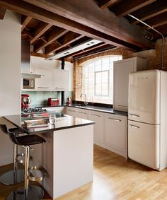 Kitchens: Small but Perfectly Formed.  Love the huge window and how it opens the space