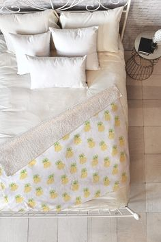 Get cozy with a pineapple print throw!