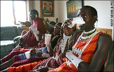 Masai warriors drinking tea while in England for the London Marathon.