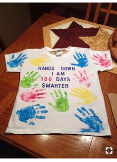 day of school shirt. 11 hand prints on front and 9 on the back. Total of 100 fingers.