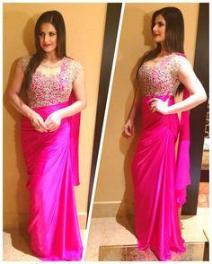Zareen Khan Wearing a Saree Gown by Sonaakshi Raaj Indian Wedding Gowns, Indian Dresses, Indian Outfits, Designer Sarees Wedding, Designer Dresses, Bridesmaid Saree, Saree Gown, Beautiful Saree, Gorgeous Hair