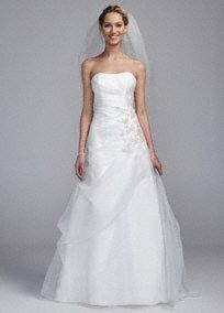 Fabulous is an understatement in this breathtaking strapless Organza embroidered gown!  Strapless A line bodice features stunning ruched detail create a flattering silhouette.  Eye-catching lace embroidery on hip adds drama and sparkle.  Available online in Ivory.  Fully lined. Back zip. Imported polyester. Dry clean. To preserve your wedding dreams, try our Wedding Gown Preservation Kit.