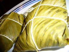 Tamales de Panama! Delicious corn dough rolls with pockets stuffed with chicken or pork, wrapped in banana leaves and boiled.