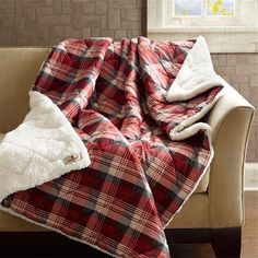 Whether+you+need+something+to+cozy+up+in+while+reading+a+book+or+a+decorative+piece+for+the+end+of+your+bed,+the+Woolrich+Tasha+Down+Alternative+Throw+is+perfect+for+your+home.+Made+from+a+softspun+fabric,+this+throw+is+soft+to+the+touch.+The+design+features+a+red+plaid+print+while+the+reverse+features+a+cozy+berber+fabric+keeping+you+warm+even+on+the+coldest+night.