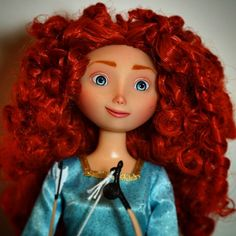 """OOAK Merida doll repaint from Disney's Pixar movie Brave.  Before she was the 12"""" Disneystore classic Merida doll. Her face is completely new painted with acrylic paints after her original paint was removed. Her hair is restyled.  I hope you like her!  #dollartistry #disney #disneyarts #officialdisneyart #disneydoll #dollrepaint #merida #disneybrave #meridadoll"""