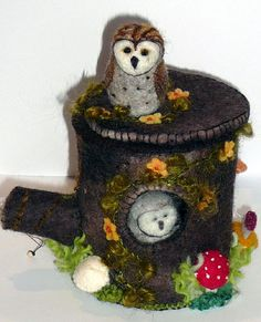 Hollow tree stump made form wool felt,fungi at base ,home to an owl family and?