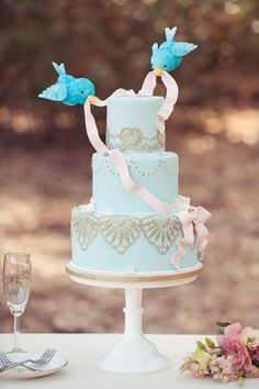 Fairytale wedding cake {Modern Cinderella} - could even be done with little lovebird toppers for the same effect but probably a little cheaper cause I think this topper would be expensive