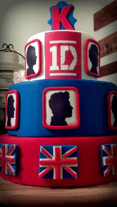 One direction Cake I want it for my birthday although I'd want Nialls section to be his flag is it bad that I can tell which boy is which...