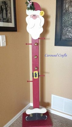 Tall Wood Stocking Holder Santa for Christmas.  Holds 4 standard size Christmas stockings. By Carousel Crafts