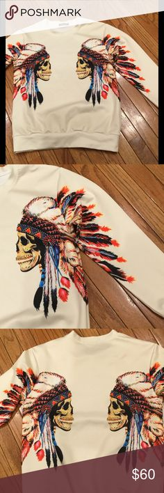 Skull w/Indian Headdress Pullover Same beautiful artwork on front and back and down each sleeve.  Photo 3 is of the back.  Stretch dry-fit fabric ..machine wash, hang to dry.  In perfect condition...never worn.  Unisex. XL runs a bit small XUAN YING Shirts Sweatshirts & Hoodies