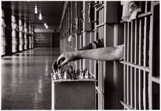 Inmates playing chess from their prison cells, by Cornell Capa, 1972