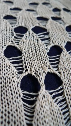 Experimental knitted sample with open holes for pattern & contrast; textiles design; close up knit detail // Pamela Cruse