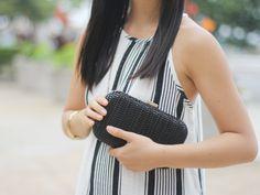 black straw clutch.