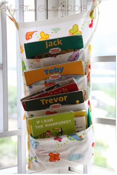 sew / diy book hanger perfect for next to kids bed or in reading nook area #sewing #diy #books #organization #kidsrooms