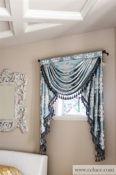 Glacial Swan - Classic Overlapping Style Light gold and white floral pattern on off light blue faux silk http://www.celuce.com/p/194/glacial-swan-swag-valance-curtains  This stunning valance brings a refreshing yet noble lustre to the surrounding. The silky fabric reminds of a herd of graceful swans floating on a peaceful glacial lake under clean blue sky.