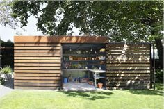 This unassuming and sleek garden shed has a secret...
