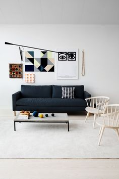 Loving the contrasting artworks here, the geometric with the traditional rug and the eyes.