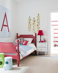 cheap diy art: take a huge canvas and paint kiddo's initial on it.  red painted bed is darling, too.