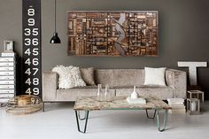 This is the exact one that is available to ship out right away. This is truly a one-of-a-kind art piece that evokes the feeling of an old industrial cityscape. I started with the river where I chose a steel blue aged wood for the water that separates the sides of the city. I then