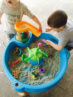 kinetic sand inside a water table for fun during the winter