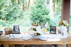 Photographs of the parents, grandparents, and great-grandparents on their wedding days displayed on the cake table from Weddings in Woodinville Real Wedding from Simply Wed. Erin Schedler Photography.