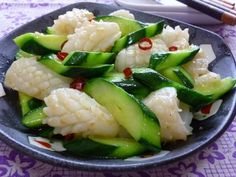 Great recipe for Chinese Stir-Fry with Squid and Cucumber. When the cucumber was in season... I often had this menu at my parent's house. This is my mother's signature recipe. I added a little extra to make an authentic Chinese-style? And I am working on it.  - I used cuttlefish this time, but you can also use todarodes pacificus (My mother makes it using things like octopus or shrimp.) - When using a big cucumber with lots of seeds, scrape the seeds off with a spoon before using it. ...