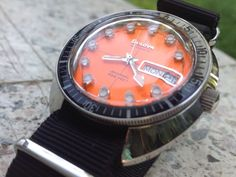 Bulova Auto Orange Dial- have this kind of watch for a very long time