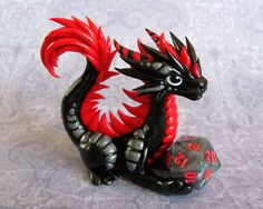 JUst look at that fluffy tail! The silver is actually a bit darker than pictured, more like a gunmetal shad. Black and Red Dice Dragon Little Dragon, Red Dragon, Dragon Art, Dragon Crafts, Dragon Statue, Baby Dragon, Silver Dragon, Polymer Clay Dragon, Polymer Clay Animals