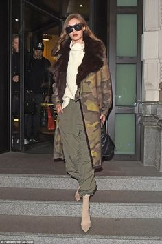 Sartorially savvy: The eldest Hadid sister, 21, looked sensational in a faux-fur lined coat and baggy khaki pants