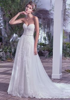 Beaded gown with sweetheart neckline and lace appliqué details I Style: Mirelle…