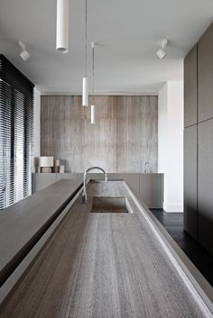 sphere concepts / kitchen in hullebusch oak grey woodstructure stone