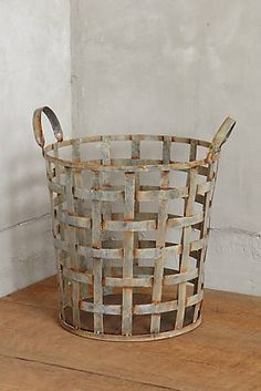 Distressed Metal Storage Basket - Anthropologie - fill it with chopped wood waiting  by the fire