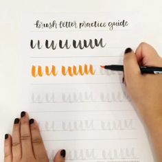 Pages from the Brush Letter Practice Guide with Tombow pens. Shown here in…