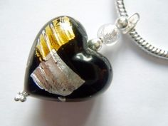 Black,silver and gold Murano glass heart pendant with sterling silver chain. £39.00
