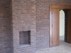Fireplace and Feature wall using a custom blend of red Brick Tiles Retro Furniture, Industrial Furniture, Red Brick Tiles, Tiles Uk, Stone Cladding, Peterborough, Red Bricks, Stoves, London