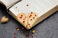 Reading Romantic Literature. This conceptual love story scene is availble for free download on the Scatter Jar homepage! www.scatterjar.com #food #foodphotography #freestock #freeresource #conceptual #love #biscuit #baking