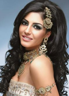 Love big hair! her make-up is perfect for an indian wedding. (by Dil Matharu)