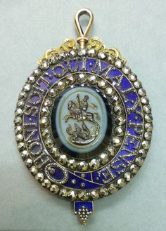 Badge of Garter and Thistle combined. The centre a three strata onyx cameo, brown, grey and black, of St George attacking dragon, encircled by blue enamelled garter and steel rose-cut jewels. Engraved on reverse figure St Andrew and motto of Thistle. Royal Jewels, Crown Jewels, Military Ribbons, Order Of The Garter, Silver Jewelry, Vintage Jewelry, The Royal Collection, Crosses Decor, Ancient Jewelry
