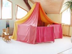 Waldorf Kindergarten Switzerland - fun building forts with canopy and play stands