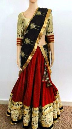 Color combination of maroon, black, and gold with temple design. Gives an ethnic type of look