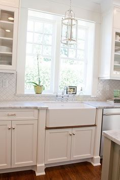 Farm sink with stained drip ledge for kitchen.  Great detail that Krisi recommended.