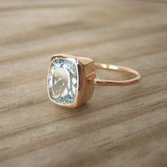 cushion-cut aquamarine in recycled 14k rose gold - I am in LOVE with blue stones and rose gold right bpw
